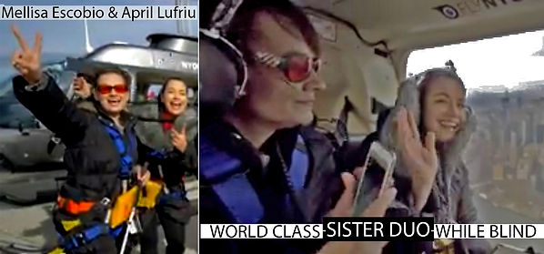 Postcard, Two women in flight harnesses in front of a helicopter in the first of two panels, in the second the women sit in the helicopter, with and smile at the camera. The Title World Class, Sister Duo, While Blind is included.