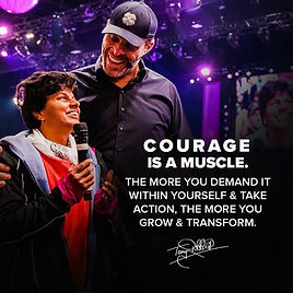 Jen Ferris standing next to Tony Robbins, who towers above her and beams, she has a microphone. Caption reads: Courage is a muscle. The More you demand it within yourself and take action, the more you grow and transform