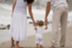 iStock_Couple_walking_with_baby_on_beach