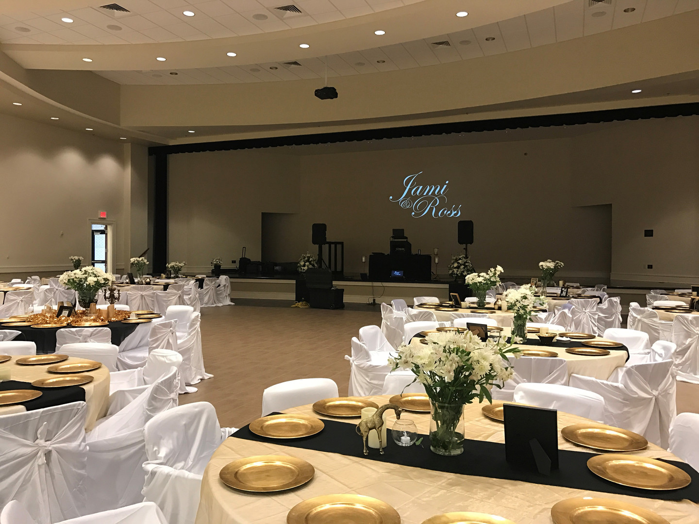 spanish fort community center multi-purpose room set up for a wedding reception - this couple has their name projected on the stage wall