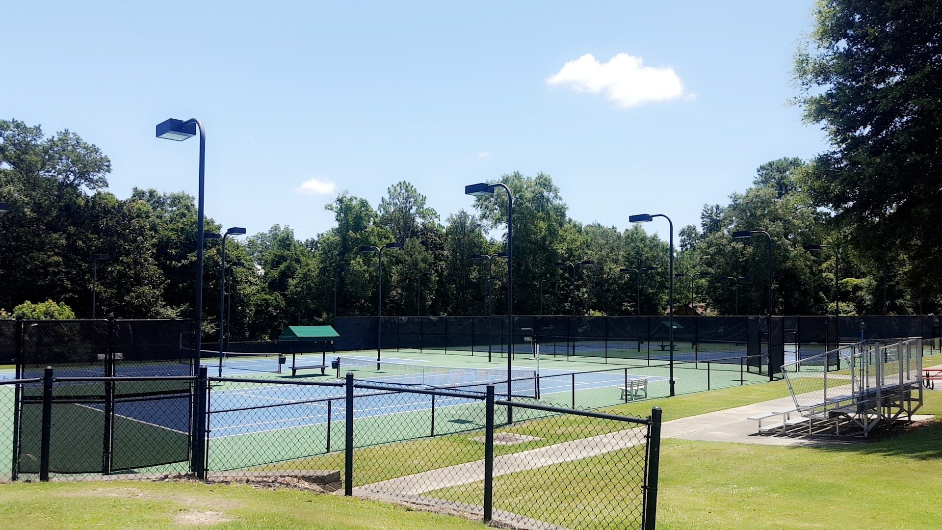 picture of empty tennis courts at spirit park