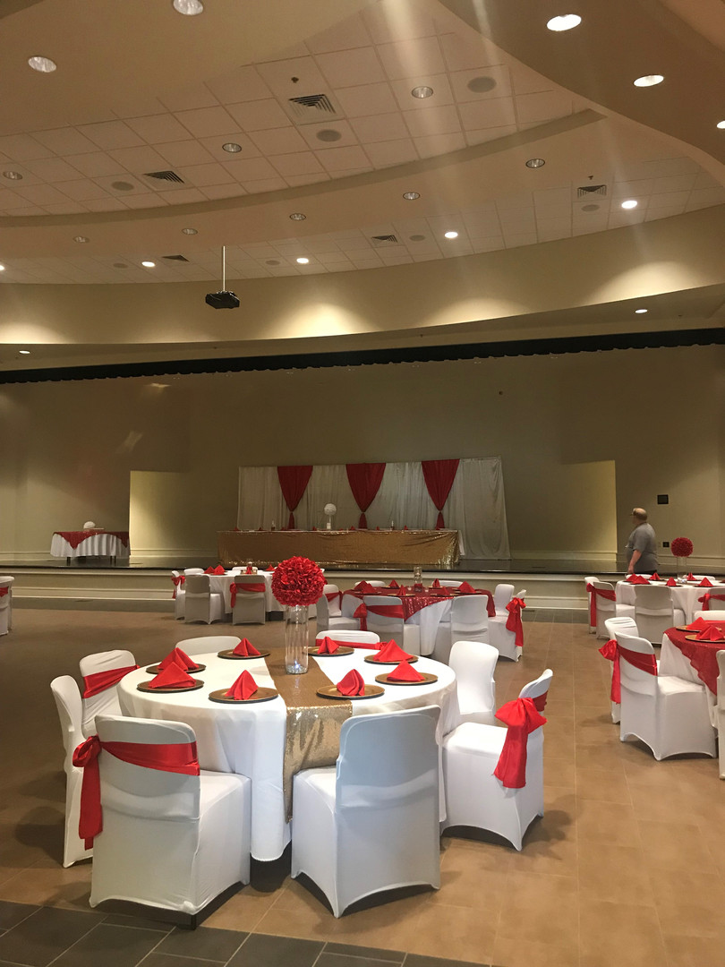 spanish fort community center multi-purpose room set up for a wedding reception -- this couple has chosen red as their color scheme