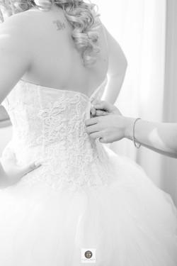 Wedding bride getting dressed