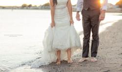 Newlywed couple walking, beach