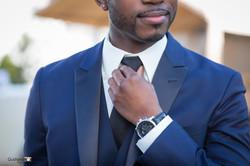 Wedding groom holding his tie