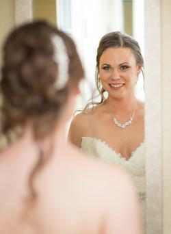 Wedding bride looking at the mirror
