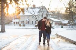 Engagement couple embracing walking