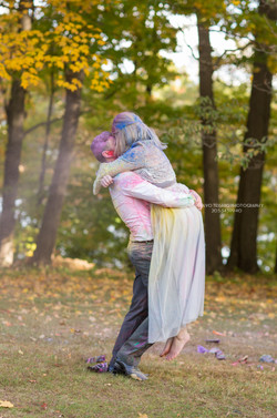 Bride and groom embracing ...