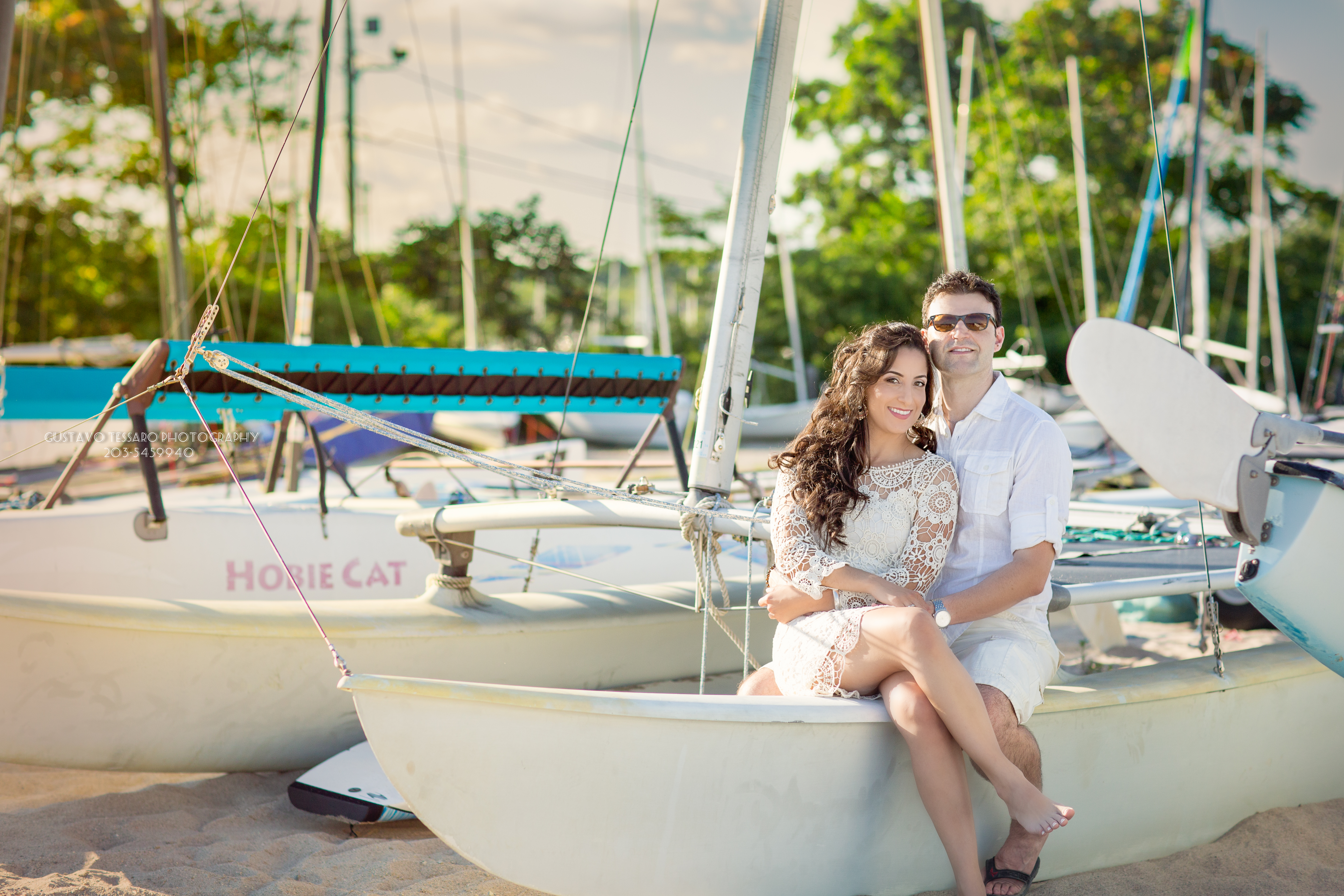 Engagement couple sitting on a boat