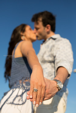 Engagement couple showing ring