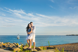 Engagement couple embracing on sunny