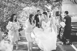 Wedding bridesmaids helping bride