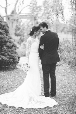 Newlyweds embracing trash the dress