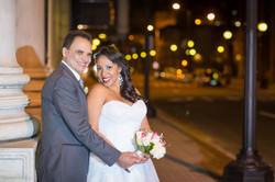 Wedding couple looking at camera