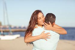 Engagement couple hugging