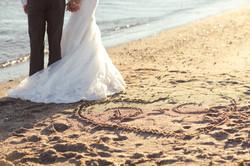 Bride and groom walking, beach