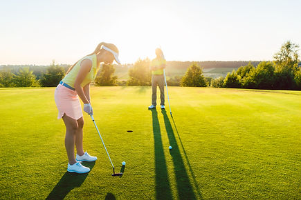 Full length side view of a female golf p