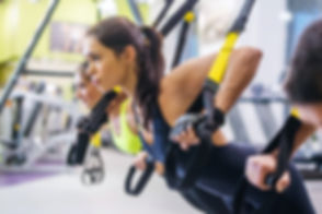 Women doing push ups training arms with