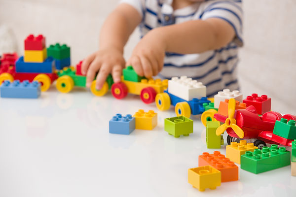 Kid playing with Lego Toys