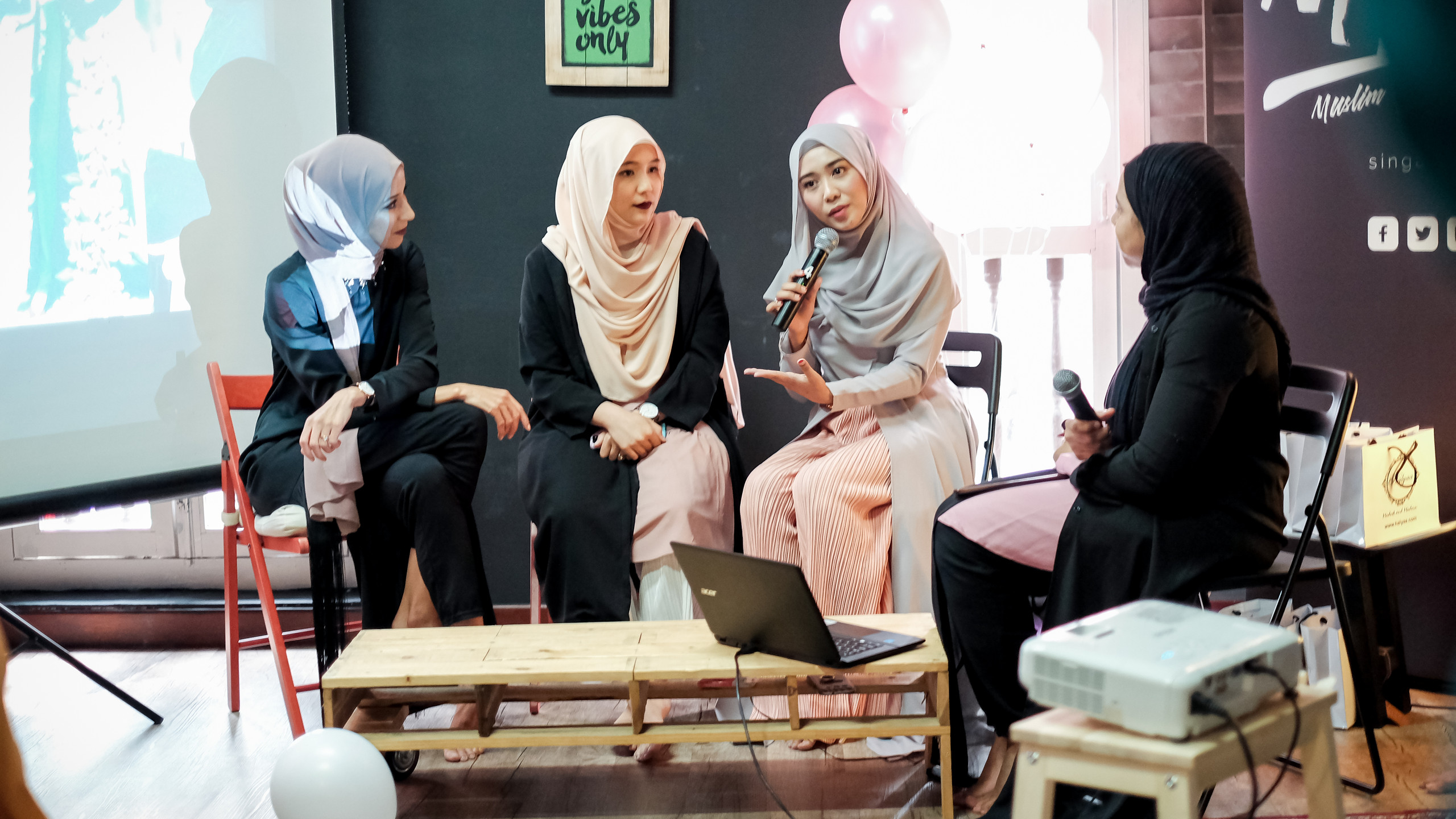 Left to right. Hasna B, modest fashion bloggers Zahra @zahraaaj, Nur Khairunnia @uhnisa, Tayeba