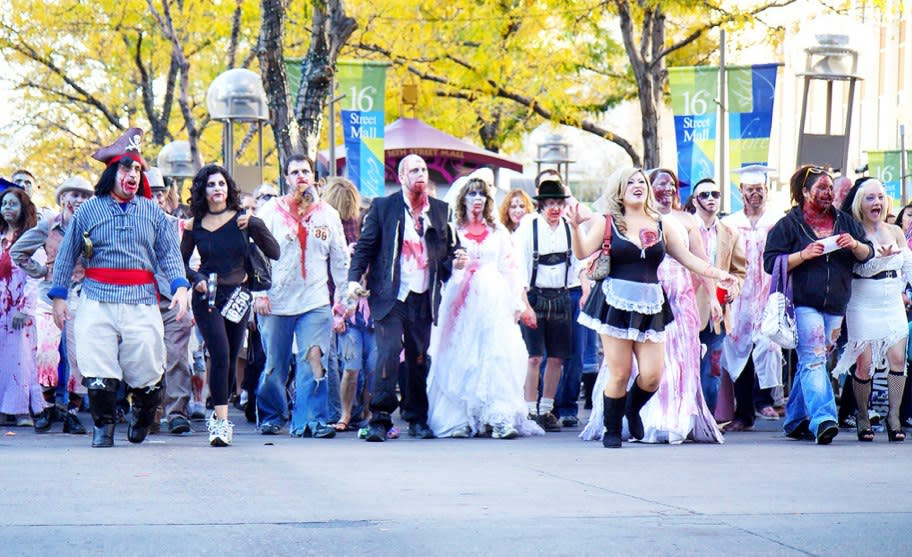 Denverites dress up as zombies and walk through the 16th street mall
