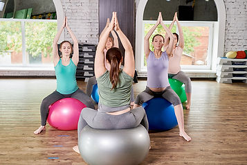 pregnant-women-enjoying-yoga-DYUS37F.jpg