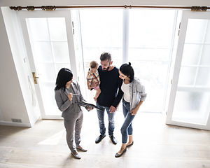 real estate agent showing family a house