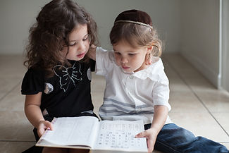 Children Studying Alphabet