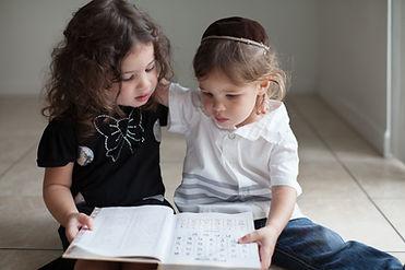 Children Studying Alphabet