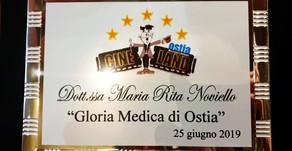 """PREMI. Conferimento di """"Gloria Medica di Ostia 2019"""" alla dottoressa Maria Rita Noviello, oncologa"""