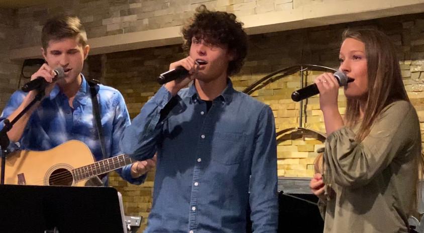 Performing at Harvey's for a preschool fundraiser.