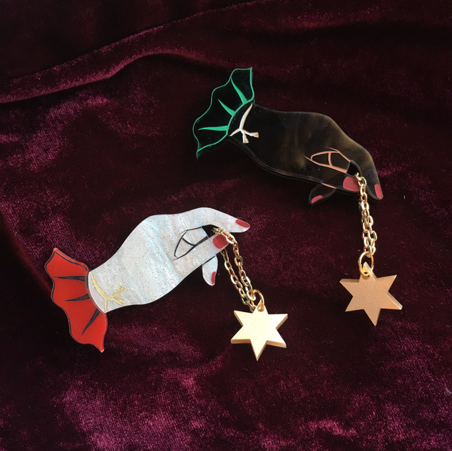 Hand and Star Brooches