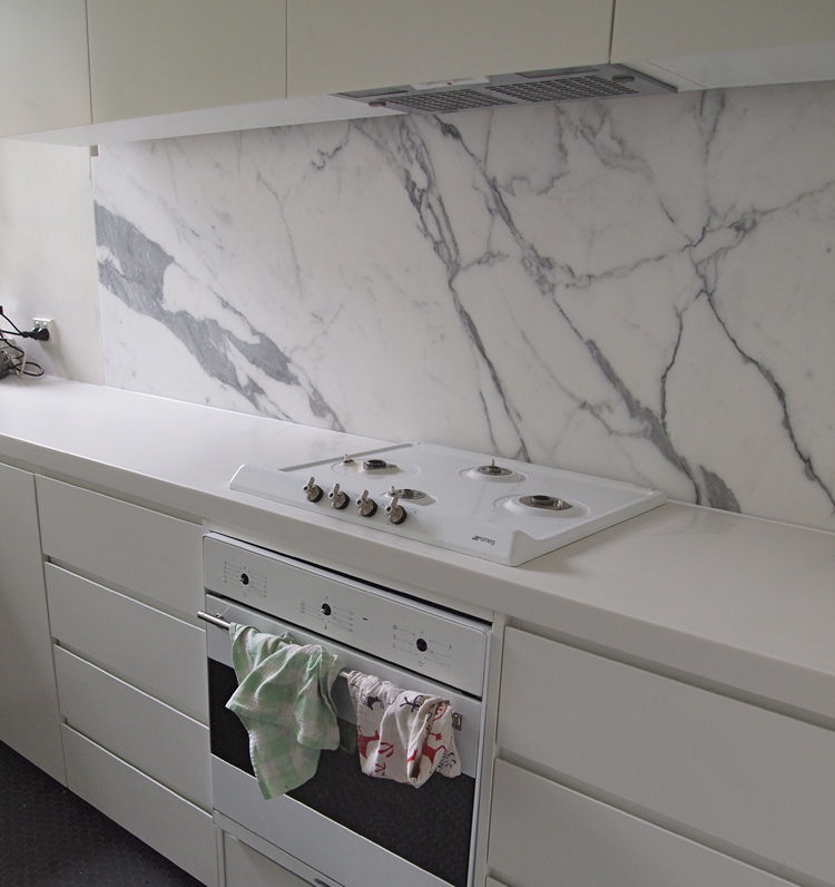White Handleless Kitchen With Carrara Marble