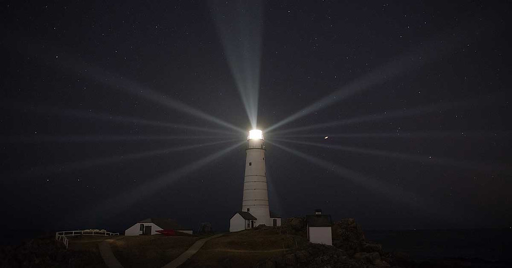 lighthouse illuminated at night - what does a management consultant do