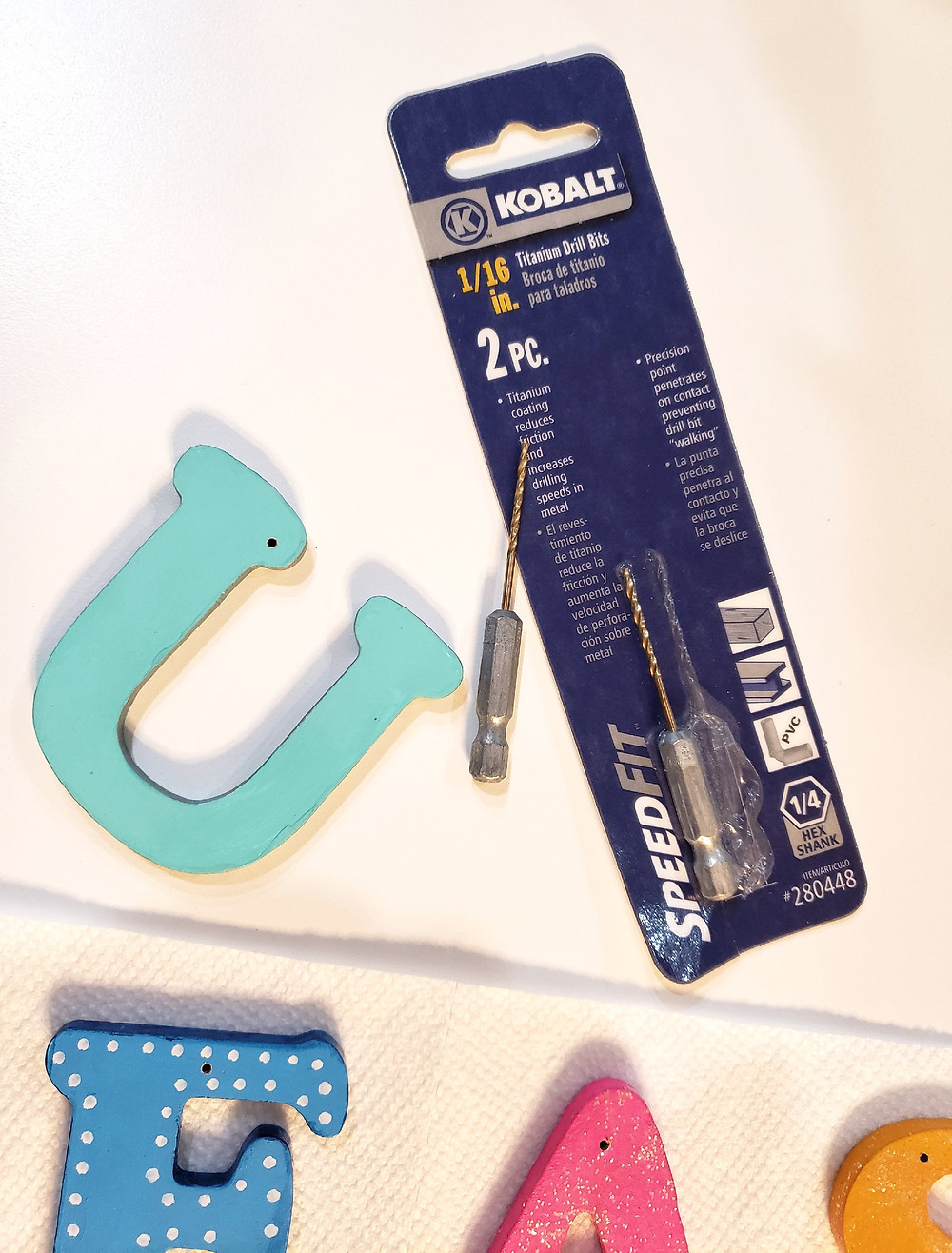 How to drill tiny holes into decorative wooden letters.