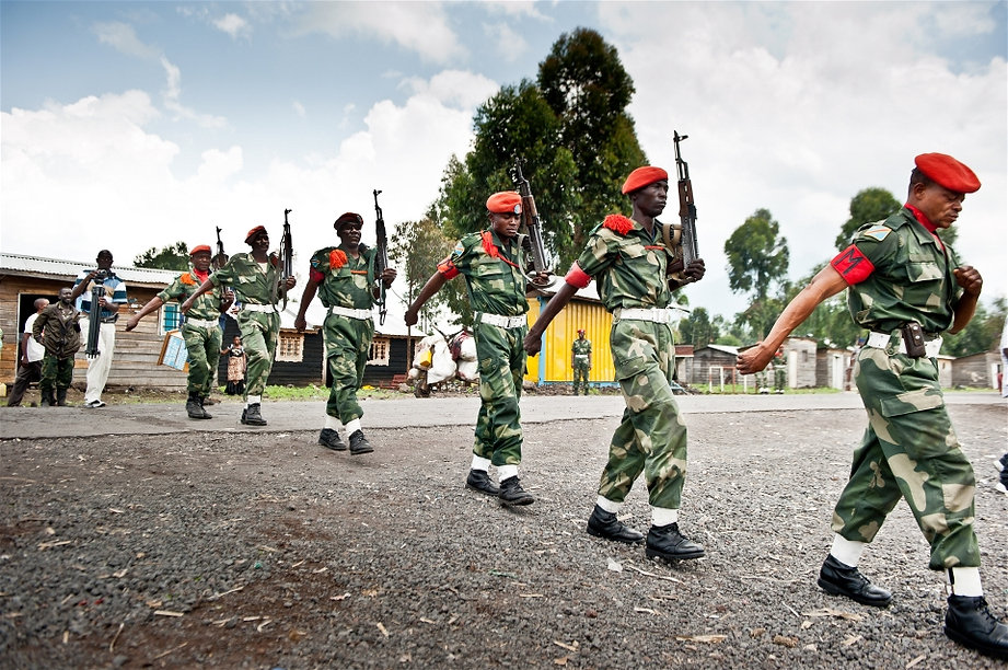 Government troops March in the eastern DRC town of Kanyaruchinya, close to the frontline with M23 rebels  © Aubrey Graham/IRIN