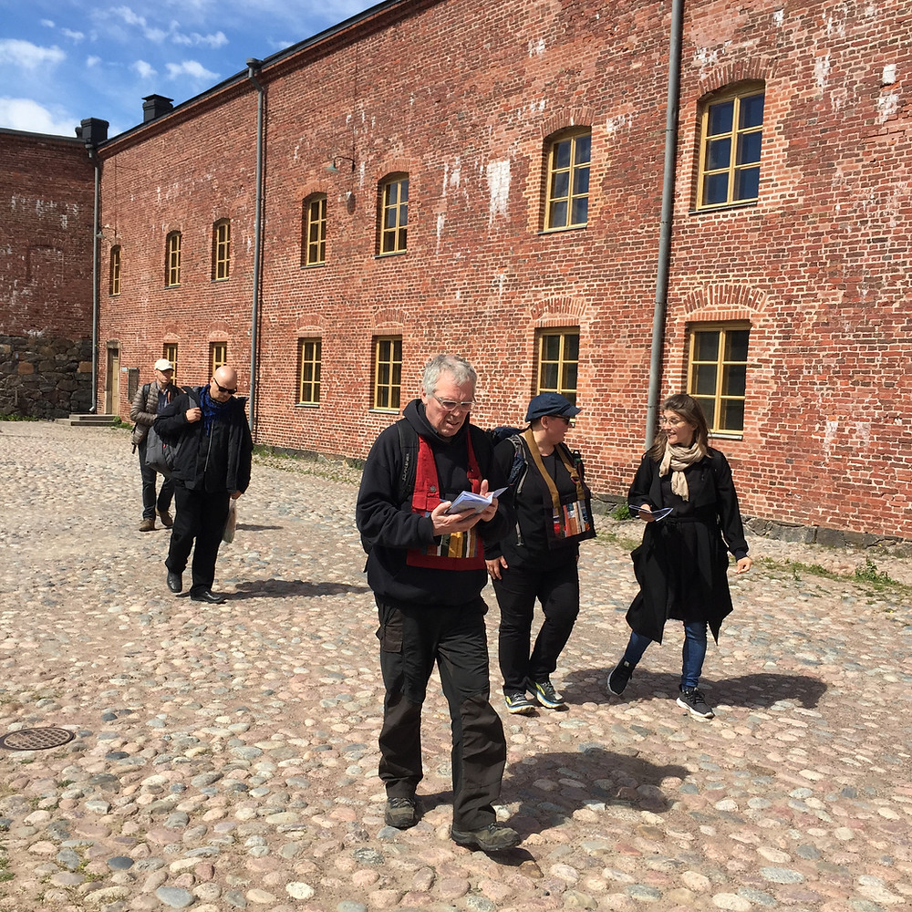 Roshi Frank visiting Suomenlinna fortress island. One of the civil war prisons on the background