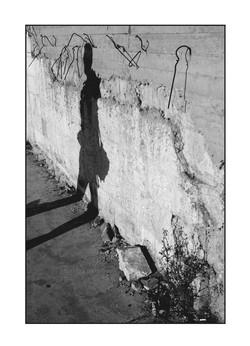 Shadow-on-Wall-of-Arafat-Co