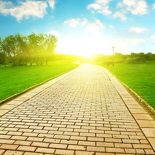 Stone pathway under sunlight in the park