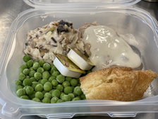 Wild rice, green peas, steak with gravy, and a crossiant roll for Salvation Army Nampa