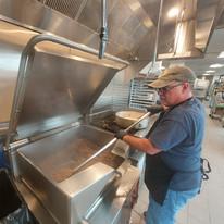 Chris using the tilt skillet to make ground beef