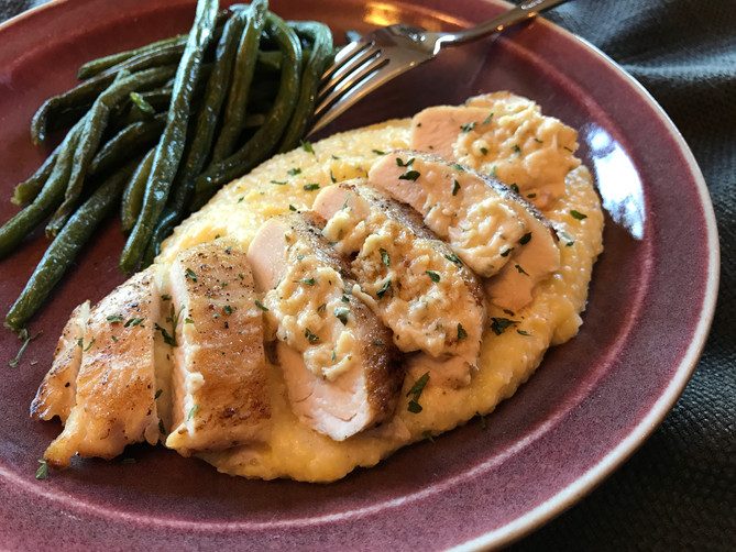 Chicken Breasts Stuffed with Herbed Cheese on Buttery Polenta