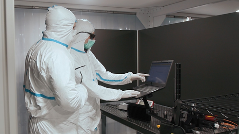 Engineers-On-Laptop-In-Cleanroom.png