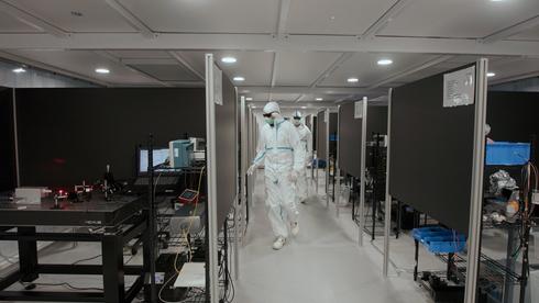 Engineers-Walking-Into-Cleanroom.png