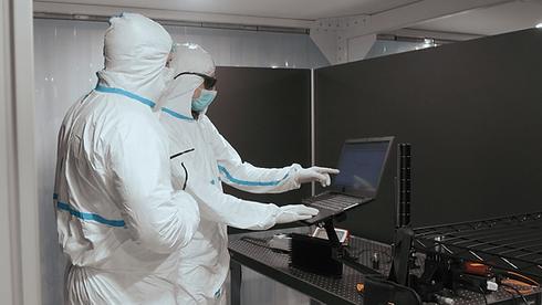 Engineers-On-Laptop-In-Cleanroom (1).png