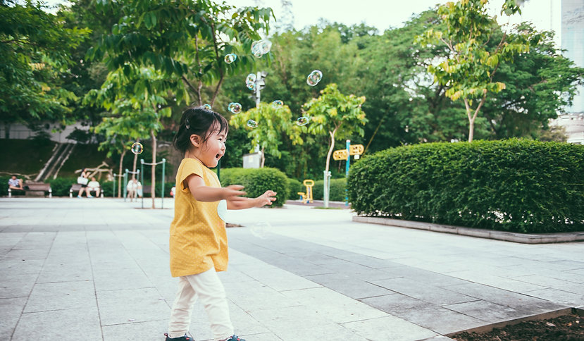 Toddler girl playing with Bubbles