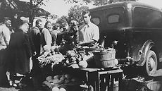 Uncle Carl selling at the old Center Street Green Market in the late 40s.