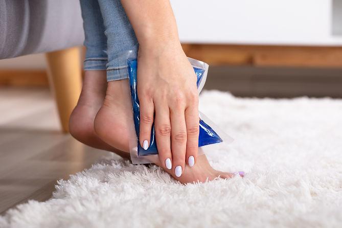 bigstock-Woman-Applying-Ice-Gel-Pack-On-