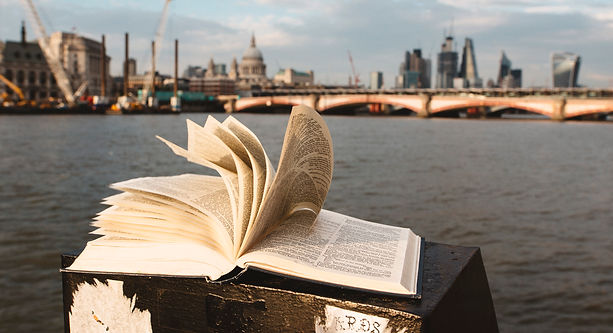 Open book with pages flipping, London in backgrond
