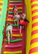 Four children having fun climbing a brig